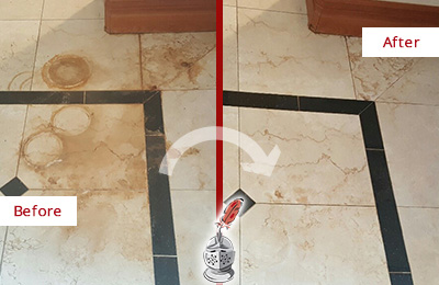 Before and After Picture of a Dripping Springs Marble Floor Honed to Remove Rust Stains